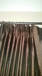 French pleat curtain panels hung with rings and french pleat clips.